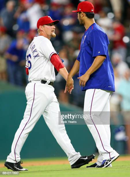 Yu Darvish of the Texas Rangers congratulates Austin BibensDirkx for his first major league start and closing out the game for the win against the...