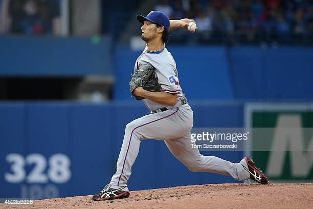 Yu Darvish of the Texas Rangers delivers a pitch in the third inning during MLB game action against the Toronto Blue Jays on July 18 2014 at Rogers...