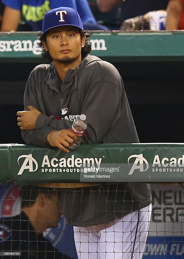 <a gi-track='captionPersonalityLinkClicked' href=/galleries/search?phrase=Yu+Darvish&family=editorial&specificpeople=4018539 ng-click='$event.stopPropagation()'>Yu Darvish</a> #11 of the Texas Rangers during a game against the Oakland Athletics in the 5th inning at Globe Life Park in Arlington on September 26, 2014 in Arlington, Texas.