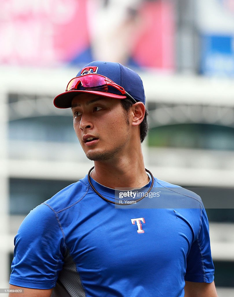 <a gi-track='captionPersonalityLinkClicked' href=/galleries/search?phrase=Yu+Darvish&family=editorial&specificpeople=4018539 ng-click='$event.stopPropagation()'>Yu Darvish</a> #11 of the Texas Rangers during batting practice before the game against the Oakland Athletics at Rangers Ballpark in Arlington on June 19, 2013 in Arlington, Texas.