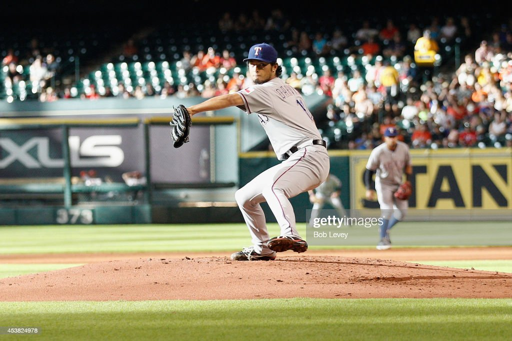 <a gi-track='captionPersonalityLinkClicked' href=/galleries/search?phrase=Yu+Darvish&family=editorial&specificpeople=4018539 ng-click='$event.stopPropagation()'>Yu Darvish</a> #11 of the Texas Rangers during game action against the Houston Astros at Minute Maid Park on August 9, 2014 in Houston, Texas.