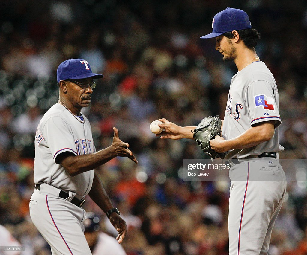 <a gi-track='captionPersonalityLinkClicked' href=/galleries/search?phrase=Yu+Darvish&family=editorial&specificpeople=4018539 ng-click='$event.stopPropagation()'>Yu Darvish</a> #11 of the Texas Rangers gives the ball to manager <a gi-track='captionPersonalityLinkClicked' href=/galleries/search?phrase=Ron+Washington&family=editorial&specificpeople=225012 ng-click='$event.stopPropagation()'>Ron Washington</a> #38 as he leaves the game in the fifth inning against the Houston Astros at Minute Maid Park on August 9, 2014 in Houston, Texas.
