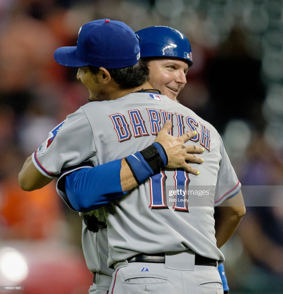 <a gi-track='captionPersonalityLinkClicked' href=/galleries/search?phrase=Yu+Darvish&family=editorial&specificpeople=4018539 ng-click='$event.stopPropagation()'>Yu Darvish</a> #11 of the Texas Rangers is hugged by catcher <a gi-track='captionPersonalityLinkClicked' href=/galleries/search?phrase=A.J.+Pierzynski&family=editorial&specificpeople=204486 ng-click='$event.stopPropagation()'>A.J. Pierzynski</a> #12 of the Texas Rangers at the end of the game against the Houston Astros at Minute Maid Park on April 2, 2013 in Houston, Texas. Darvish made it to the ninth inning of a near perfect game before allowing a hit on the final out.