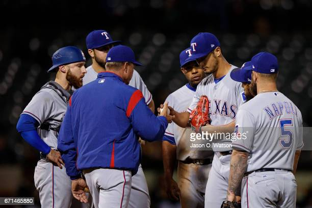 Yu Darvish of the Texas Rangers is relieved by manager Jeff Banister during the sixth inning against the Oakland Athletics at the Oakland Coliseum on...