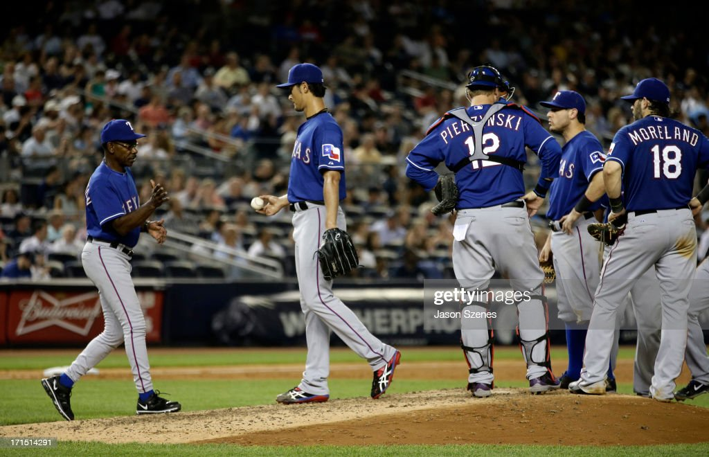 <a gi-track='captionPersonalityLinkClicked' href=/galleries/search?phrase=Yu+Darvish&family=editorial&specificpeople=4018539 ng-click='$event.stopPropagation()'>Yu Darvish</a> #11 of the Texas Rangers (C) is taken out of the game by manager <a gi-track='captionPersonalityLinkClicked' href=/galleries/search?phrase=Ron+Washington&family=editorial&specificpeople=225012 ng-click='$event.stopPropagation()'>Ron Washington</a> #38 in the seventh inning against the New York Yankees at Yankee Stadium on June 25, 2013 in the Bronx borough of New York City.