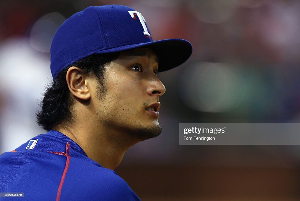 <a gi-track='captionPersonalityLinkClicked' href=/galleries/search?phrase=Yu+Darvish&family=editorial&specificpeople=4018539 ng-click='$event.stopPropagation()'>Yu Darvish</a> #11 of the Texas Rangers looks on as the Rangers take on the Toronto Blue Jays in the bottom of the fourth inning at Globe Life Park in Arlington on August 26, 2015 in Arlington, Texas.