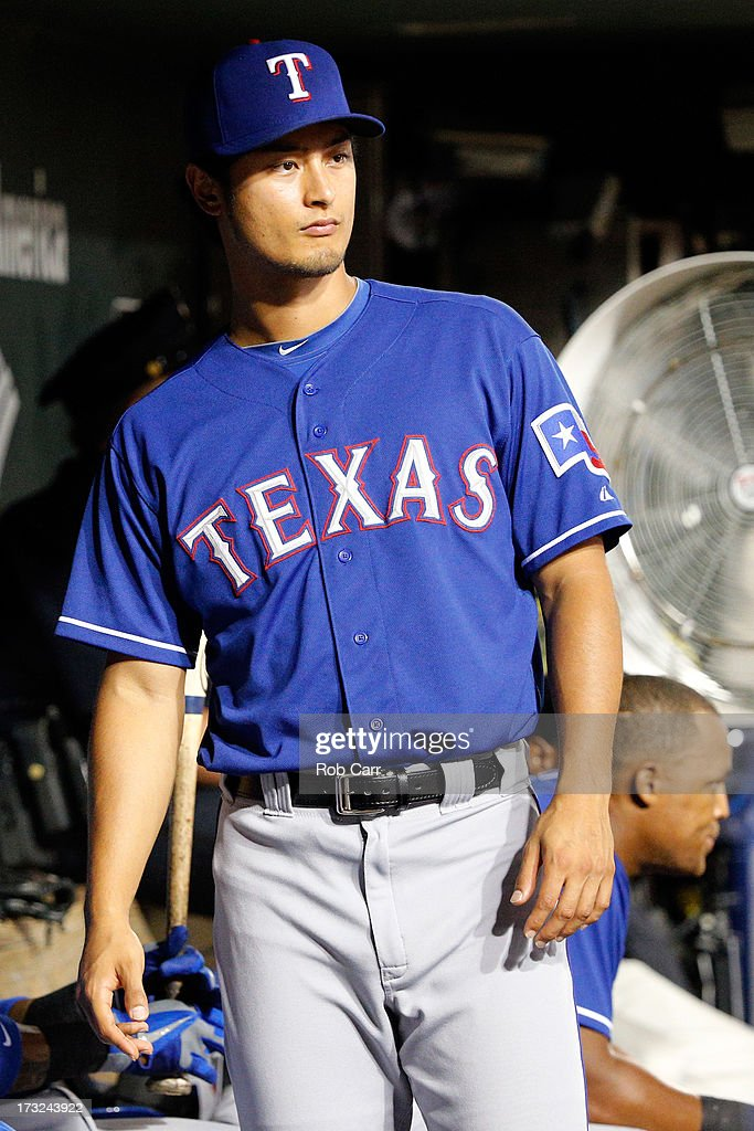 Yu Darvish #11 of the Texas Rangers looks on from the dugout during the ninth inning of the Rangers 6-1 loss to the Baltimore Orioles at Oriole Park at Camden Yards on July 10, 2013 in Baltimore, Maryland.