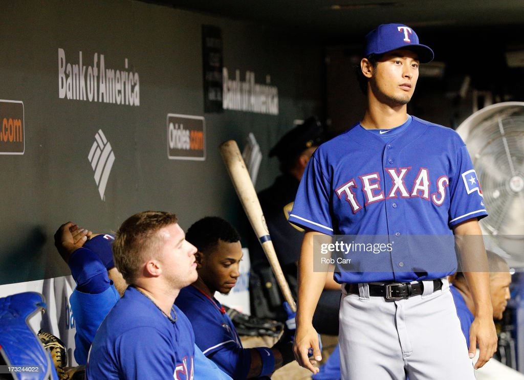 <a gi-track='captionPersonalityLinkClicked' href=/galleries/search?phrase=Yu+Darvish&family=editorial&specificpeople=4018539 ng-click='$event.stopPropagation()'>Yu Darvish</a> #11 of the Texas Rangers looks on from the dugout during the ninth inning of the Rangers 6-1 loss to the Baltimore Orioles at Oriole Park at Camden Yards on July 10, 2013 in Baltimore, Maryland.