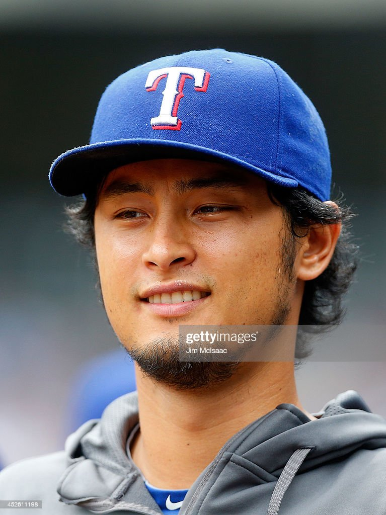 Yu Darvish #11 of the Texas Rangers looks on from the dugout in the first inning against the New York Yankees at Yankee Stadium on July 24, 2014 in the Bronx borough of New York City.