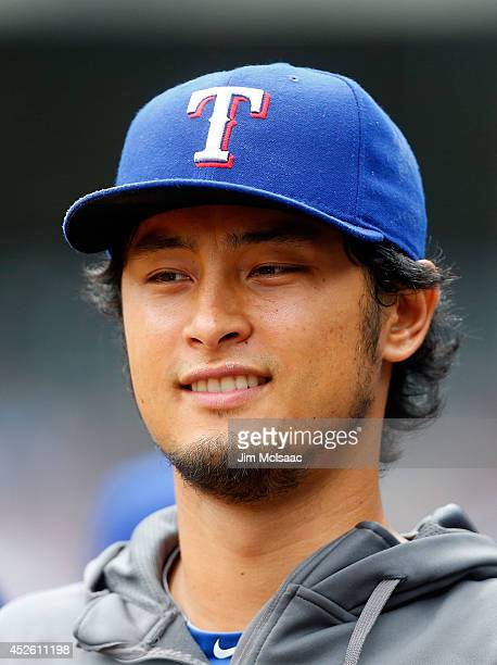 Yu Darvish of the Texas Rangers looks on from the dugout in the first inning against the New York Yankees at Yankee Stadium on July 24 2014 in the...