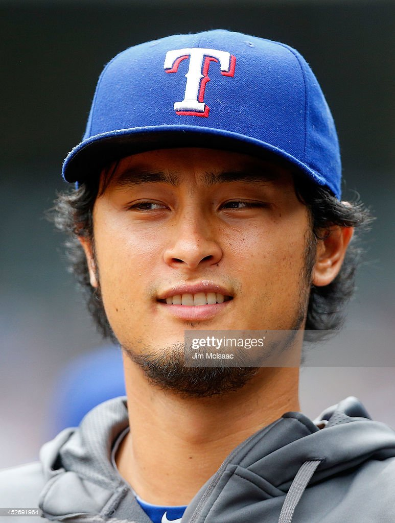 Yu Darvish #11 of the Texas Rangers looks on from the dugout in the first inning against the New York Yankees at Yankee Stadium on July 24, 2014 in the Bronx borough of New York City. The Yankees defeated the Rangers 4-2.