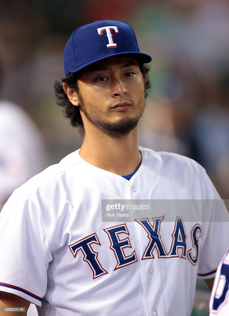 <a gi-track='captionPersonalityLinkClicked' href=/galleries/search?phrase=Yu+Darvish&family=editorial&specificpeople=4018539 ng-click='$event.stopPropagation()'>Yu Darvish</a> #11 of the Texas Rangers looks on from the dugout in the eighth inning against the Tampa Bay Rays at Globe Life Park in Arlington on August 11, 2014 in Arlington, Texas.