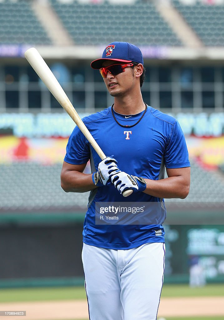 <a gi-track='captionPersonalityLinkClicked' href=/galleries/search?phrase=Yu+Darvish&family=editorial&specificpeople=4018539 ng-click='$event.stopPropagation()'>Yu Darvish</a> #11 of the Texas Rangers pauses before going into the batting cage before the game against the Oakland Athletics in preparation for a series against the St. Louis Cardinals in St.Louis at Rangers Ballpark in Arlington on June 19, 2013 in Arlington, Texas.