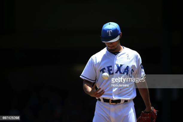 Yu Darvish of the Texas Rangers pauses between pitches against the Seattle Mariners during the first inning at Globe Life Park in Arlington on June...