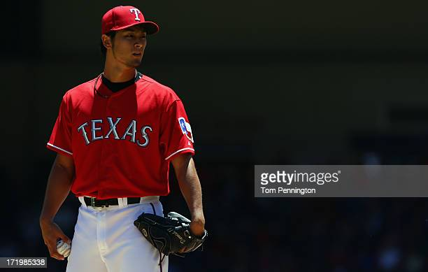Yu Darvish of the Texas Rangers pitches againnst the Cincinnati Reds in the top outfield the first inning at Rangers Ballpark in Arlington on June 30...