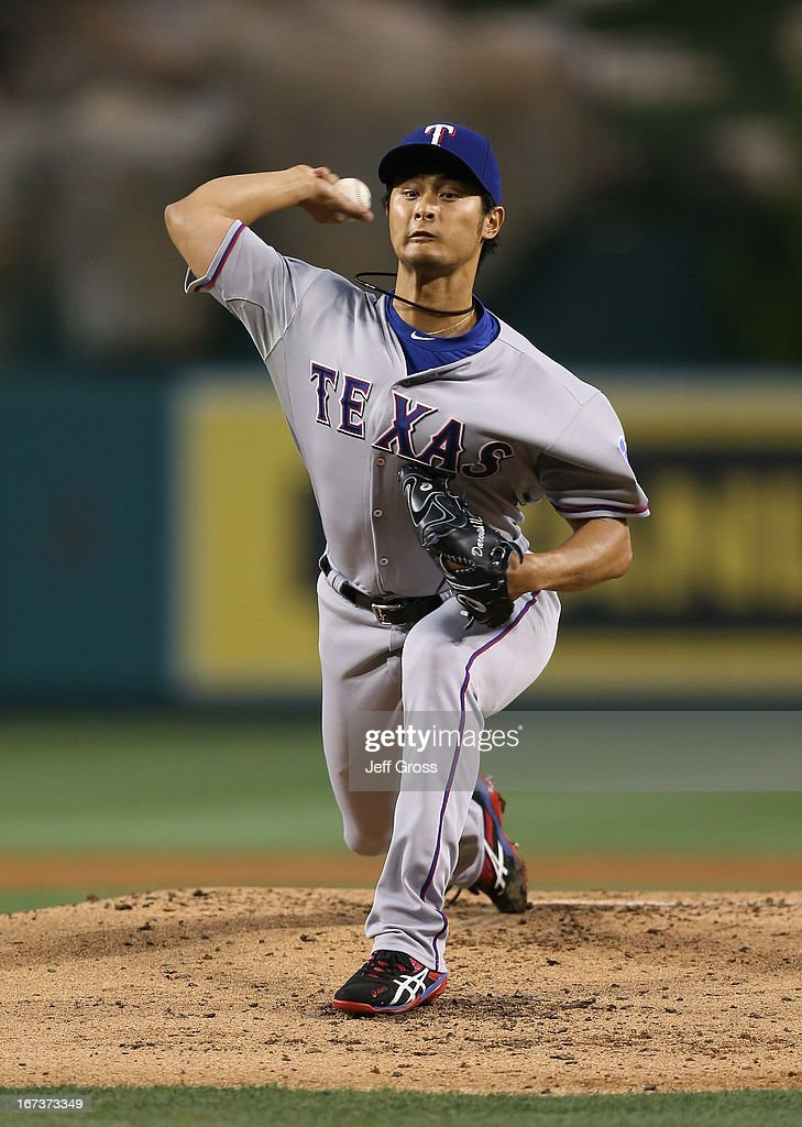 <a gi-track='captionPersonalityLinkClicked' href=/galleries/search?phrase=Yu+Darvish&family=editorial&specificpeople=4018539 ng-click='$event.stopPropagation()'>Yu Darvish</a> #11 of the Texas Rangers pitches against the Los Angeles Angels of Anaheim in the first inning at Angel Stadium of Anaheim on April 24, 2013 in Anaheim, California.