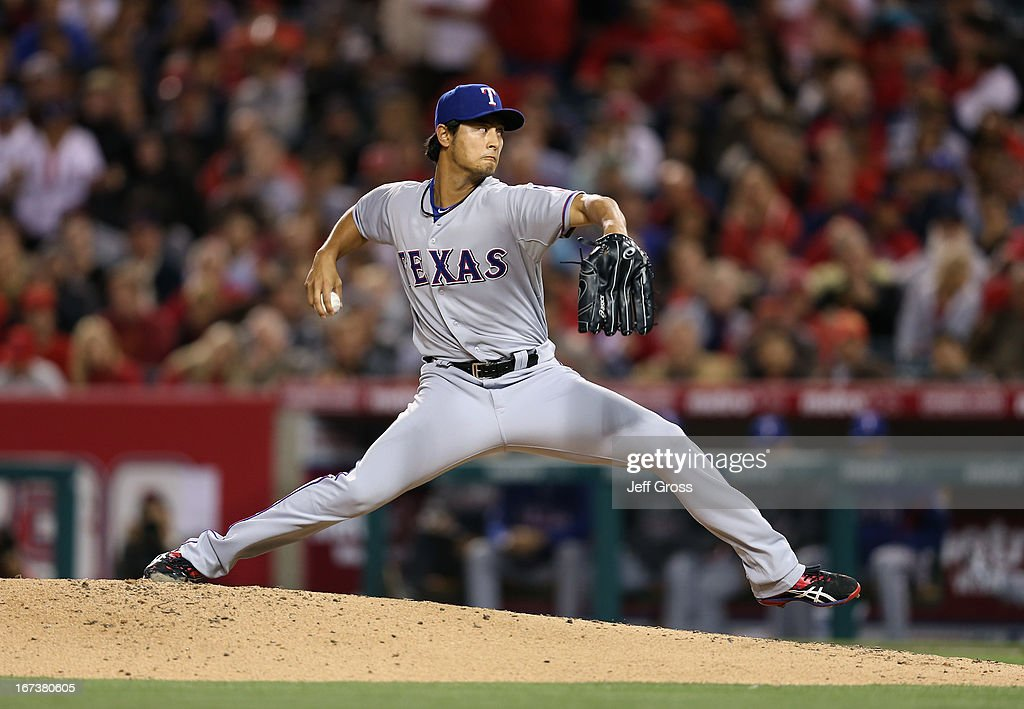 <a gi-track='captionPersonalityLinkClicked' href=/galleries/search?phrase=Yu+Darvish&family=editorial&specificpeople=4018539 ng-click='$event.stopPropagation()'>Yu Darvish</a> #11 of the Texas Rangers pitches against the Los Angeles Angels of Anaheim in the second inning at Angel Stadium of Anaheim on April 24, 2013 in Anaheim, California.