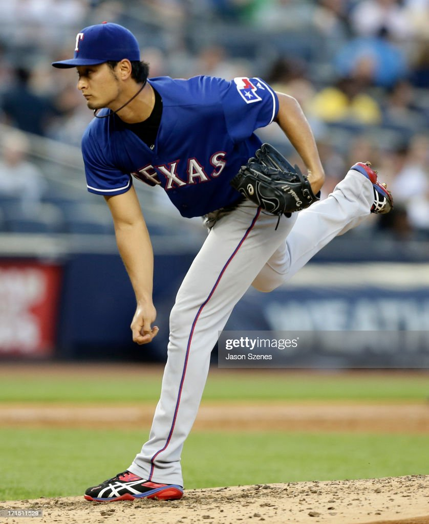 <a gi-track='captionPersonalityLinkClicked' href=/galleries/search?phrase=Yu+Darvish&family=editorial&specificpeople=4018539 ng-click='$event.stopPropagation()'>Yu Darvish</a> #11 of the Texas Rangers pitches against the New York Yankees at Yankee Stadium on June 25, 2013 in the Bronx borough of New York City.