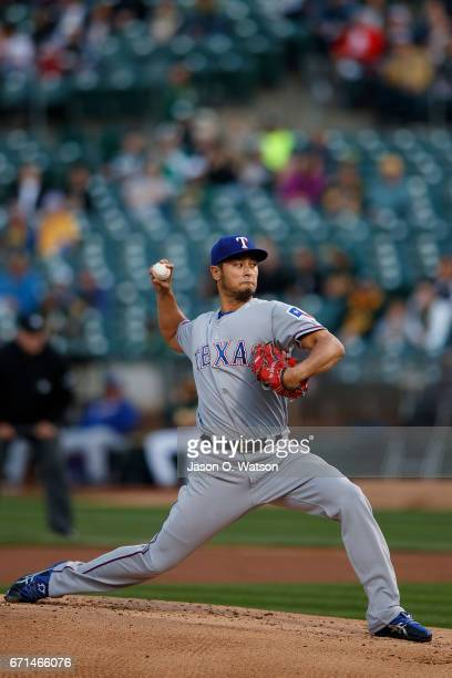 Yu Darvish of the Texas Rangers pitches against the Oakland Athletics during the first inning at the Oakland Coliseum on April 18 2017 in Oakland...