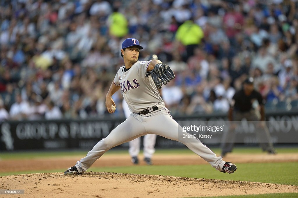 <a gi-track='captionPersonalityLinkClicked' href=/galleries/search?phrase=Yu+Darvish&family=editorial&specificpeople=4018539 ng-click='$event.stopPropagation()'>Yu Darvish</a> #11 of the Texas Rangers pitches during the 2013 Civil Rights Game against the Chicago White Sox at U.S. Cellular Field on August 24, 2013 in Chicago, Illinois. The White Sox won 3-2.
