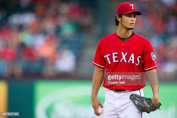 Yu Darvish of the Texas Rangers pitches during the first inning against the Houston Astros on July 9 2014 at Globe Life Park in Arlington in...