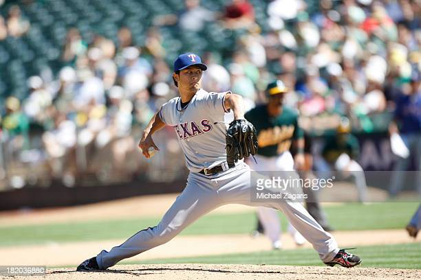 Yu Darvish of the Texas Rangers pitches during the game against the Oakland Athletics at Oco Coliseum on September 4 2013 in Oakland California The...