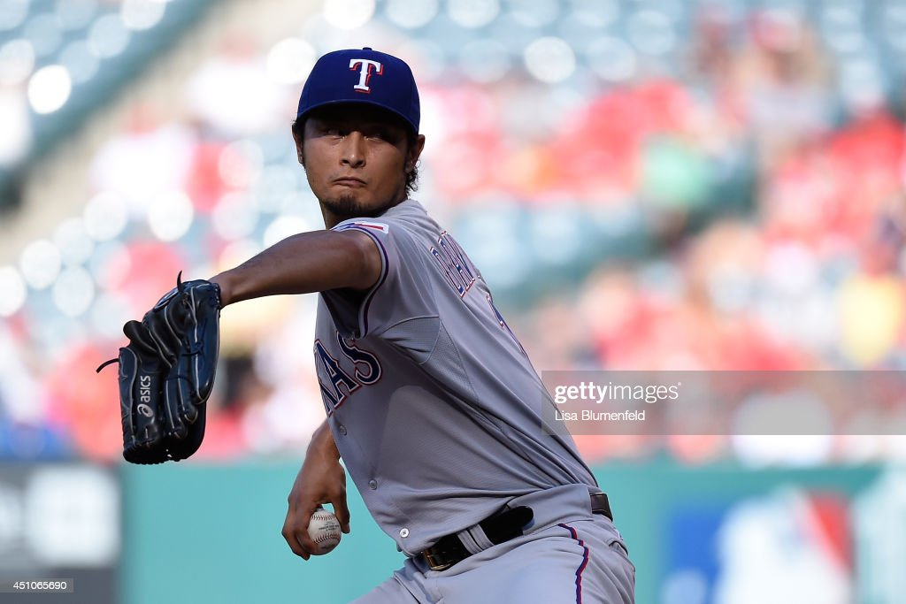 <a gi-track='captionPersonalityLinkClicked' href=/galleries/search?phrase=Yu+Darvish&family=editorial&specificpeople=4018539 ng-click='$event.stopPropagation()'>Yu Darvish</a> #11 of the Texas Rangers pitches in the first inning against the Los Angeles Angels of Anaheim at Angel Stadium of Anaheim on June 22, 2014 in Anaheim, California.