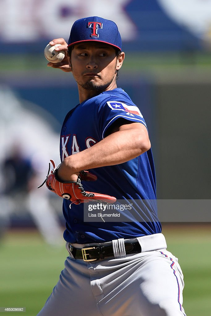 <a gi-track='captionPersonalityLinkClicked' href=/galleries/search?phrase=Yu+Darvish&family=editorial&specificpeople=4018539 ng-click='$event.stopPropagation()'>Yu Darvish</a> #11 of the Texas Rangers pitches in the first inning against the Kansas City Royals at Surprise Stadium on March 5, 2015 in Surprise, Arizona.