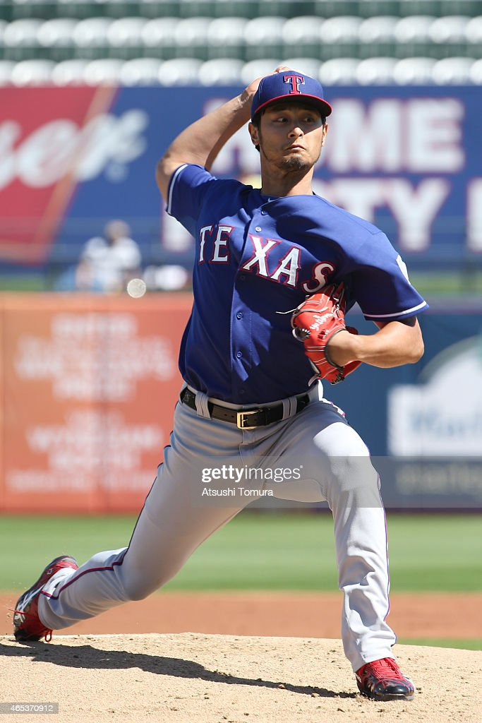 Yu Darvish of the Texas Rangers pitches in the first inning against the Kansas City Royals at Surprise Stadium on March 5 2015 in Surprise Arizona