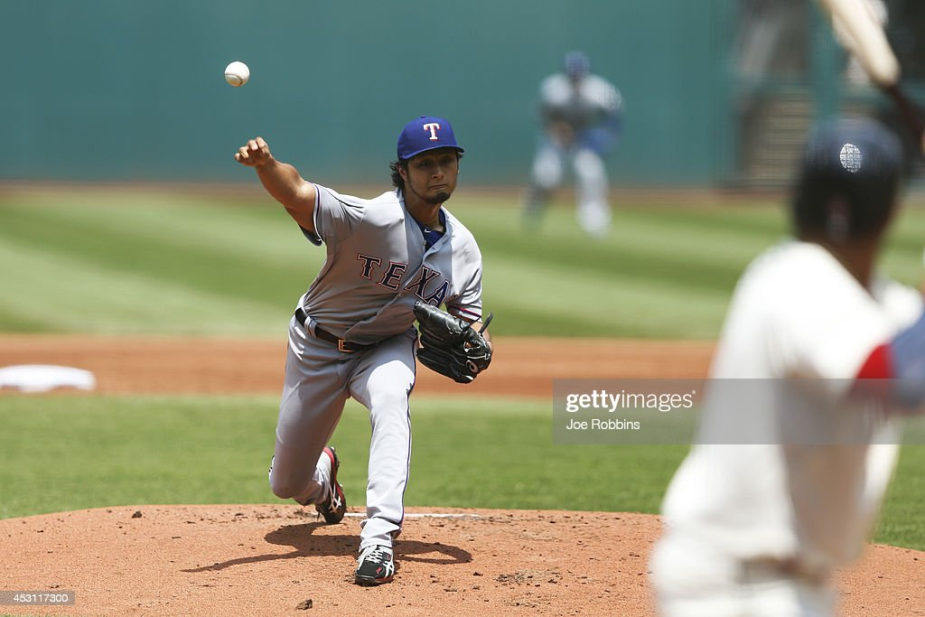 Yu Darvish #11 of the Texas Rangers pitches in the first inning of the game against the Cleveland Indians at Progressive Field on August 3, 2014 in Cleveland, Ohio.