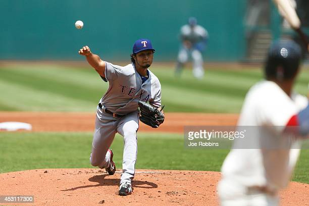 Yu Darvish of the Texas Rangers pitches in the first inning of the game against the Cleveland Indians at Progressive Field on August 3 2014 in...