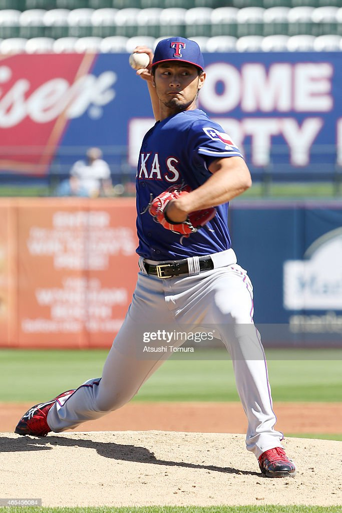 Yu Darvish of the Texas Rangers pitches in the spring training game against the Kansas City Royals at Surprise Stadium on March 5 2015 in Surprise...