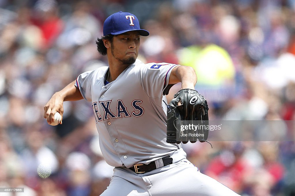 <a gi-track='captionPersonalityLinkClicked' href=/galleries/search?phrase=Yu+Darvish&family=editorial&specificpeople=4018539 ng-click='$event.stopPropagation()'>Yu Darvish</a> #11 of the Texas Rangers pitches in the third inning of the game against the Cleveland Indians at Progressive Field on August 3, 2014 in Cleveland, Ohio.