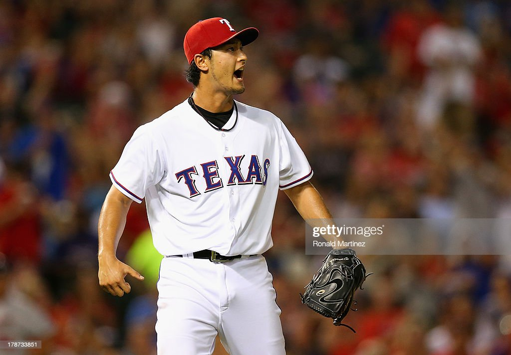<a gi-track='captionPersonalityLinkClicked' href=/galleries/search?phrase=Yu+Darvish&family=editorial&specificpeople=4018539 ng-click='$event.stopPropagation()'>Yu Darvish</a> #11 of the Texas Rangers reacts after making the final out of the sixth inning against the Minnesota Twins at Rangers Ballpark in Arlington on August 30, 2013 in Arlington, Texas.