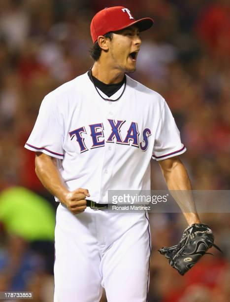 Yu Darvish of the Texas Rangers reacts after making the final out of the sixth inning against the Minnesota Twins at Rangers Ballpark in Arlington on...