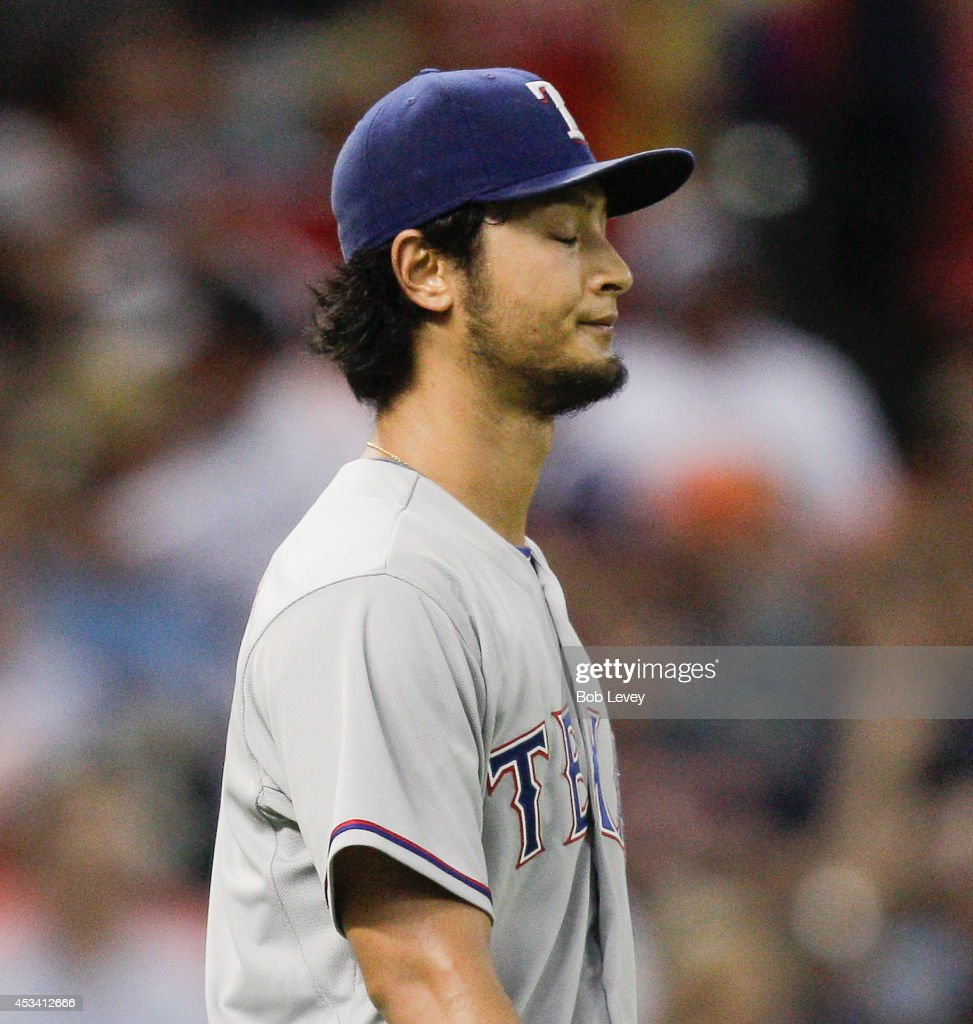 Yu Darvish #11 of the Texas Rangers reacts to giving up a two run double to Jon Singleton #28 of the Houston Astros in the fifth inning at Minute Maid Park on August 9, 2014 in Houston, Texas.