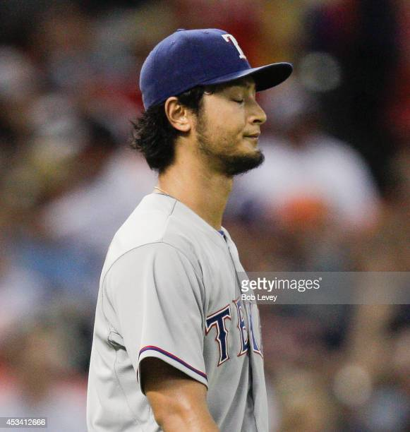 Yu Darvish of the Texas Rangers reacts to giving up a two run double to Jon Singleton of the Houston Astros in the fifth inning at Minute Maid Park...
