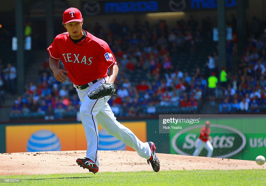 <a gi-track='captionPersonalityLinkClicked' href=/galleries/search?phrase=Yu+Darvish&family=editorial&specificpeople=4018539 ng-click='$event.stopPropagation()'>Yu Darvish</a> #11 of the Texas Rangers recovers and throws out Jacoby Ellsbury #2 of the Boston Red Sox in the third inning at Rangers Ballpark in Arlington on May 5, 2013 in Arlington, Texas.