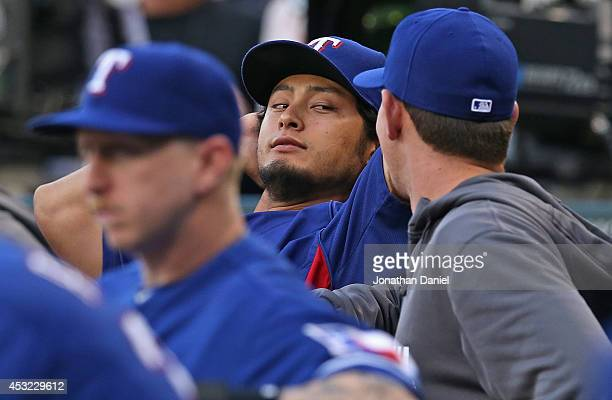 Yu Darvish of the Texas Rangers relaxes in the dugout during a game against the Chicago White Sox at US Cellular Field on August 5 2014 in Chicago...