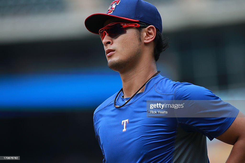 Yu Darvish #11 of the Texas Rangers runs to the batting cage during batting practice against the Oakland Athletics at Rangers Ballpark in Arlington on June 19, 2013 in Arlington, Texas.