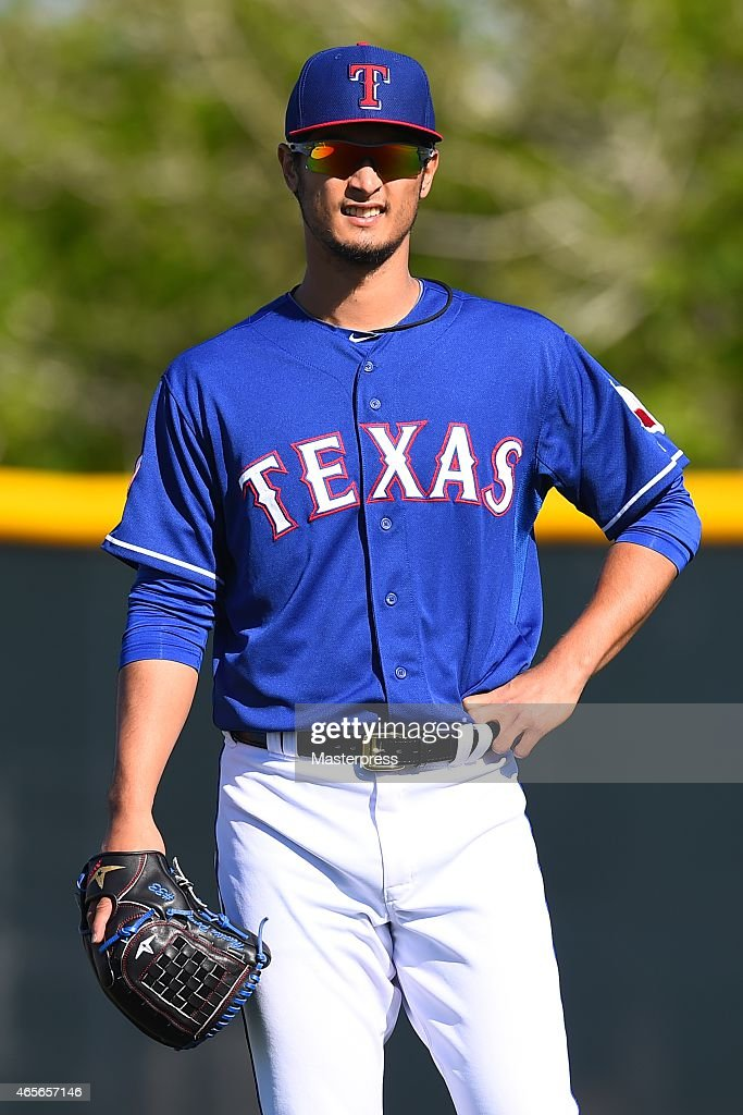 Yu Darvish #11 of the Texas Rangers smiles as he works out during the spring training at the Surprise Stadium on March 8, 2015 in Surprise, Arizona.