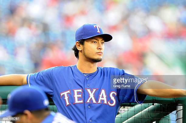 Yu Darvish of the Texas Rangers stands in the dugout before the game against the Washington Nationals at Nationals Park on May 30 2014 in Washington...