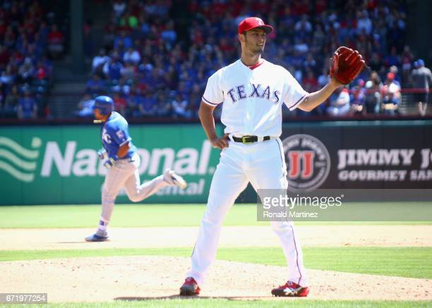 Yu Darvish of the Texas Rangers steps off the mound after giving up a home run against Jorge Bonifacio of the Kansas City Royals in the third inning...