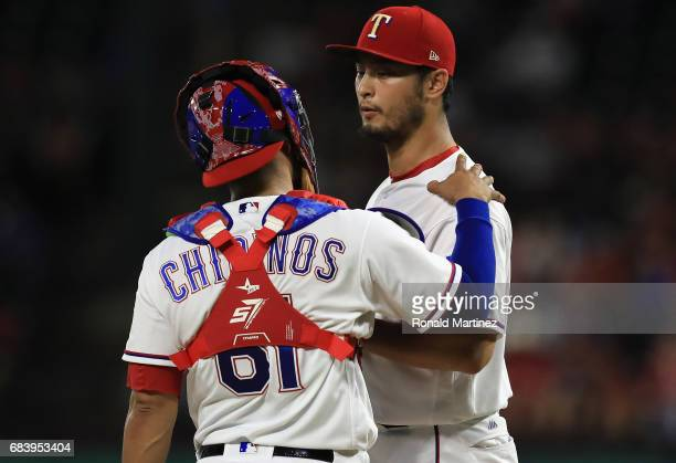 Yu Darvish of the Texas Rangers talks with Robinson Chirinos of the Texas Rangers in the sixth inning against the Philadelphia Phillies at Globe Life...