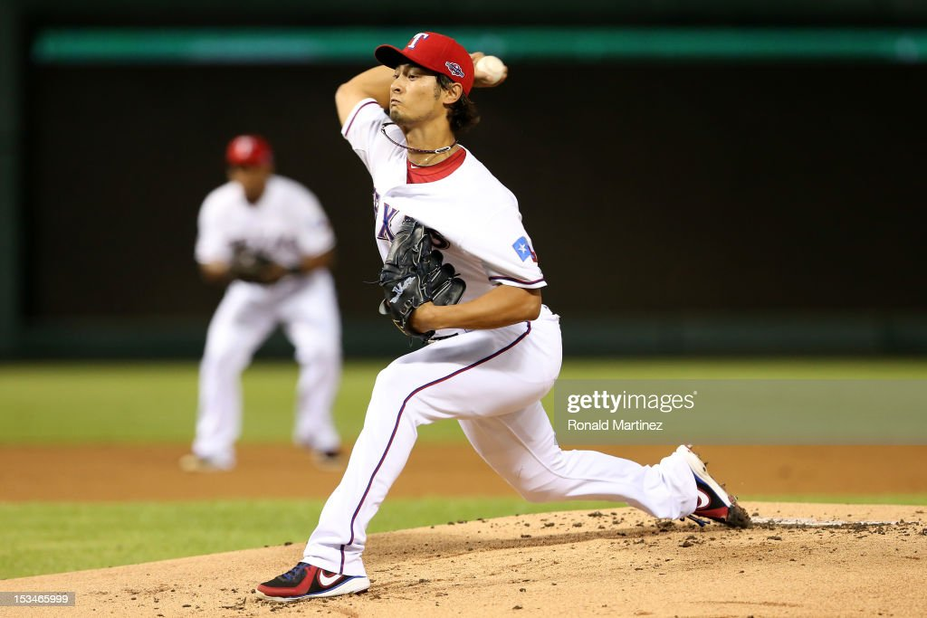 <a gi-track='captionPersonalityLinkClicked' href=/galleries/search?phrase=Yu+Darvish&family=editorial&specificpeople=4018539 ng-click='$event.stopPropagation()'>Yu Darvish</a> #11 of the Texas Rangers throws a pitch against the Baltimore Orioles during the American League Wild Card playoff game at Rangers Ballpark in Arlington on October 5, 2012 in Arlington, Texas.