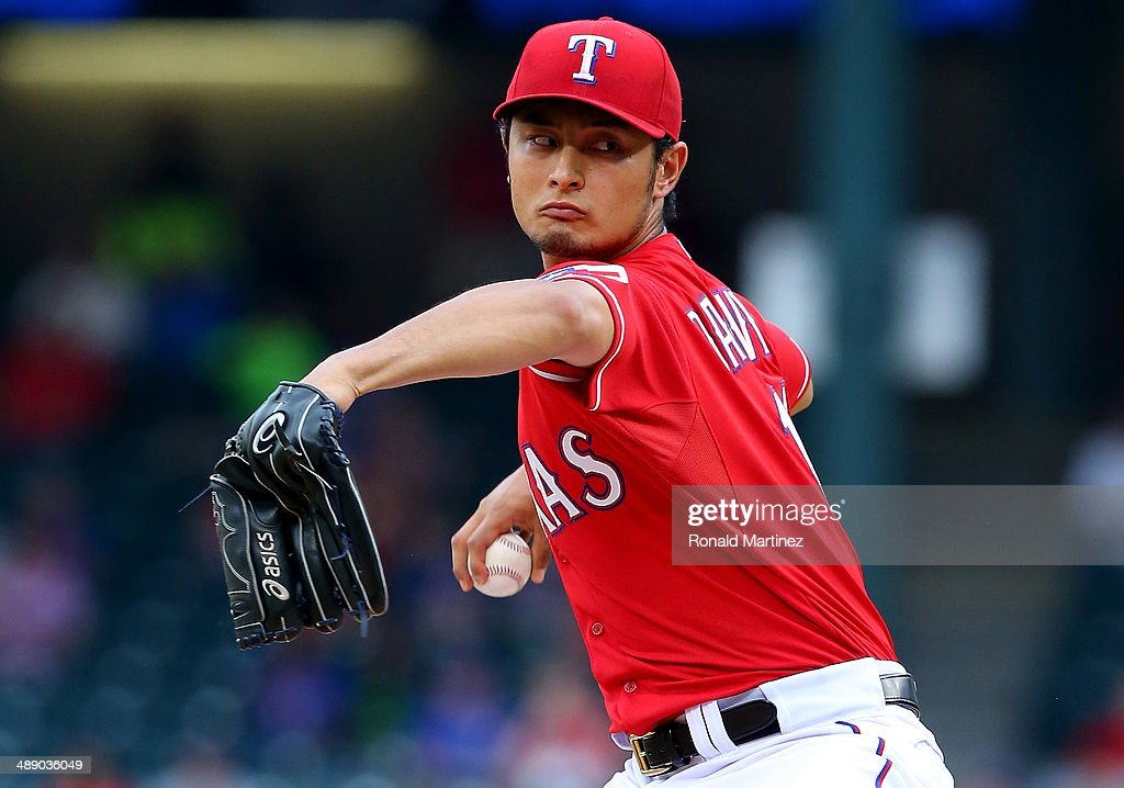 <a gi-track='captionPersonalityLinkClicked' href=/galleries/search?phrase=Yu+Darvish&family=editorial&specificpeople=4018539 ng-click='$event.stopPropagation()'>Yu Darvish</a> #11 of the Texas Rangers throws against the Boston Red Sox in the first inning at Globe Life Park in Arlington on May 9, 2014 in Arlington, Texas.