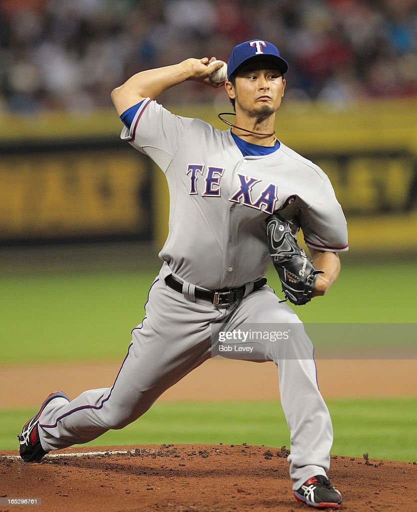 <a gi-track='captionPersonalityLinkClicked' href=/galleries/search?phrase=Yu+Darvish&family=editorial&specificpeople=4018539 ng-click='$event.stopPropagation()'>Yu Darvish</a> #11 of the Texas Rangers throws against the Houston Astros at Minute Maid Park on April 2, 2013 in Houston, Texas.