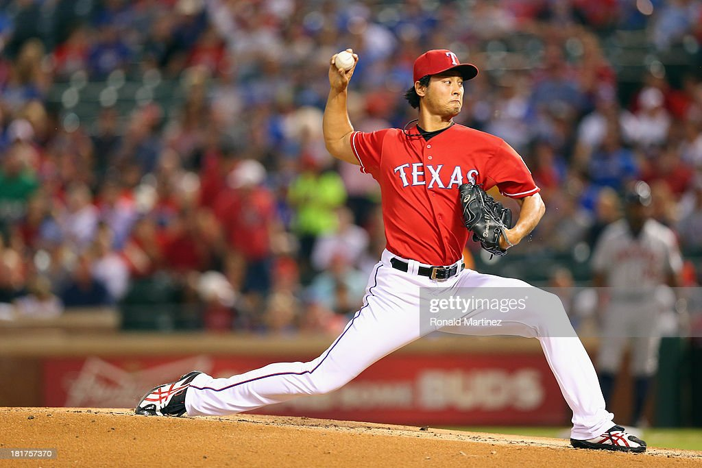 Yu Darvish #11 of the Texas Rangers throws against the Houston Astros in the second inning at Rangers Ballpark in Arlington on September 24, 2013 in Arlington, Texas.