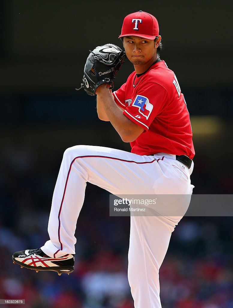 <a gi-track='captionPersonalityLinkClicked' href=/galleries/search?phrase=Yu+Darvish&family=editorial&specificpeople=4018539 ng-click='$event.stopPropagation()'>Yu Darvish</a> #11 of the Texas Rangers throws against the Los Angeles Angels in the first inning at Rangers Ballpark in Arlington on September 29, 2013 in Arlington, Texas.