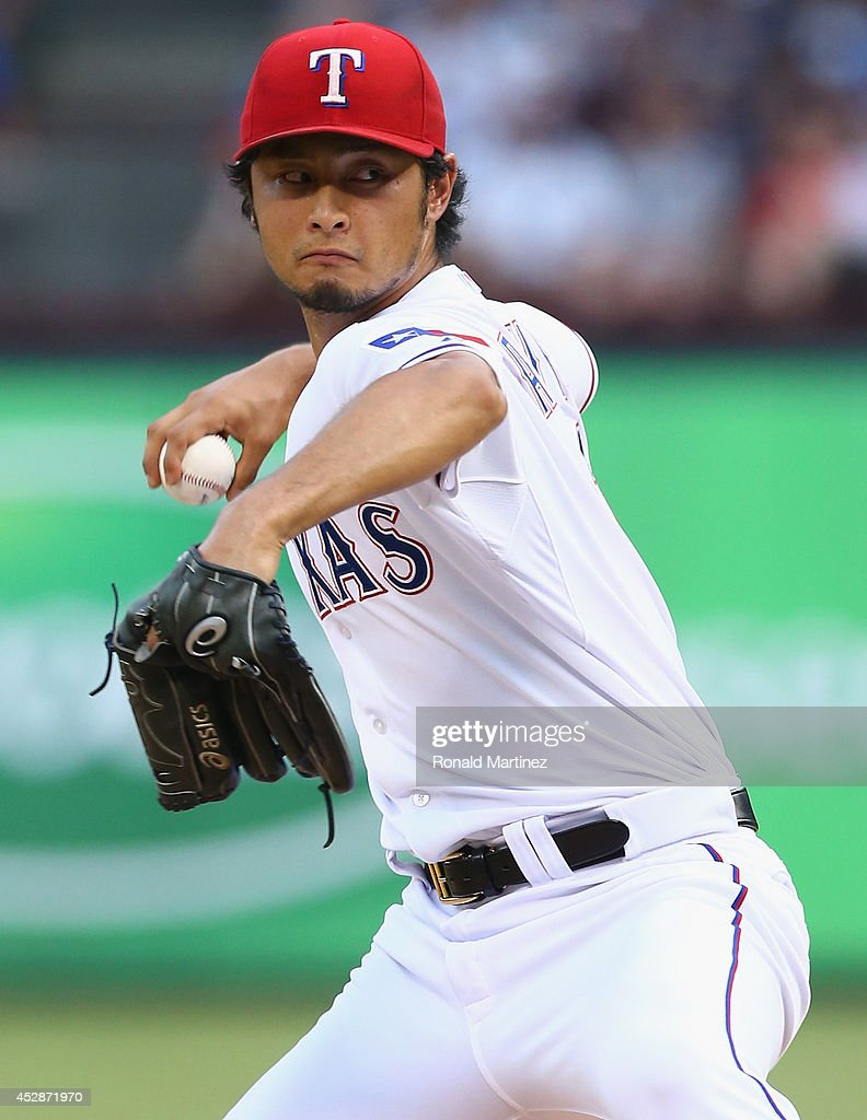 Yu Darvish #11 of the Texas Rangers throws against the New York Yankees in the third inning at Globe Life Park in Arlington on July 28, 2014 in Arlington, Texas.